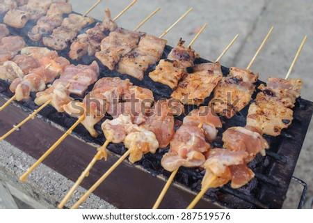 grilling pork in local market - stock photo