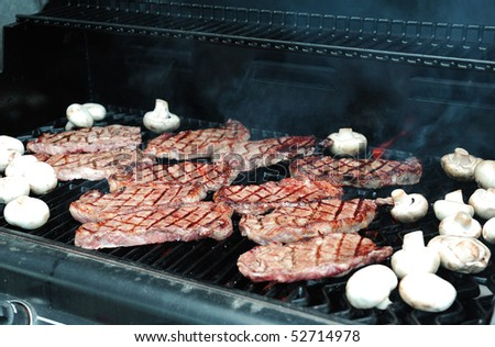 grilling steaks - stock photo