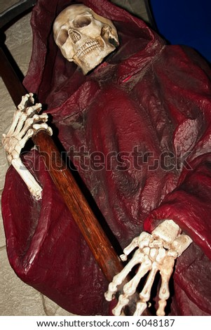 Grim Reaper with scythe - stock photo