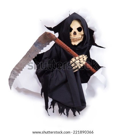 Grim reaper with scythe in hole - stock photo