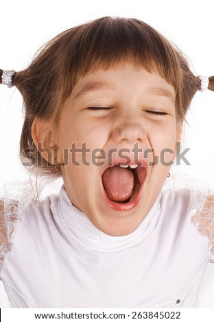Grimacing girl with wide open mouth and eyes closed, with pigtails in white blouse on white background - stock photo