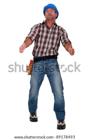 Grimacing workman isolated on white background - stock photo