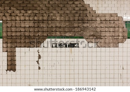 Grimy wall at West 4th subway station in Manhattan, New York, NY, USA. - stock photo
