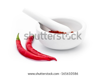 Grinded red paprika spice in the mortar isolated on white background - stock photo