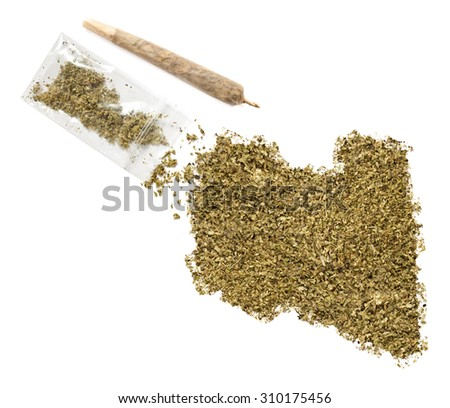 Grinded weed shaped as Libya and a joint.(series) - stock photo