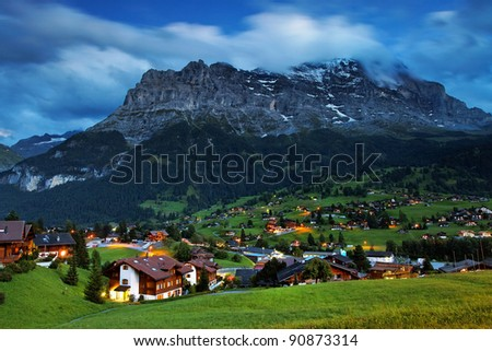 Grindelwald Village and Eiger Peak, Switzerland - stock photo
