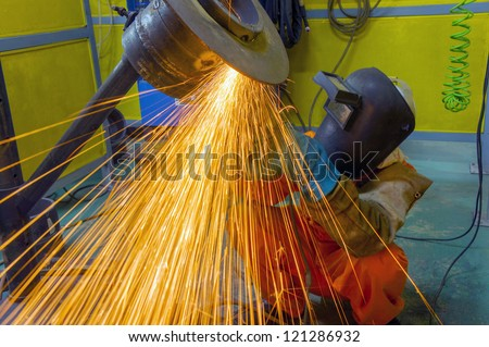 grinder pipe work and fire sparkling - stock photo
