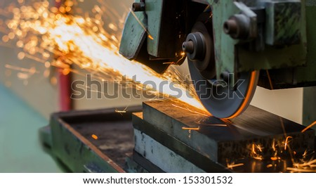 grinding machine on work and spark - stock photo