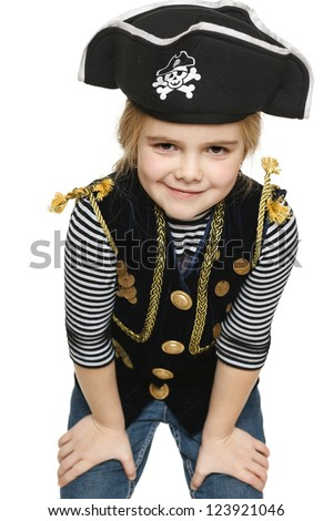 Grinning little girl wearing pirate costume, over white background - stock photo