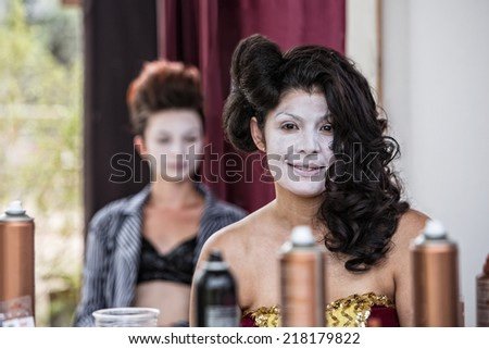 Grinning young female cirque clown smiling backstage - stock photo