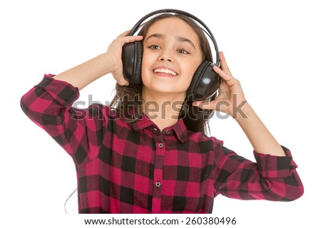 grins teen girl holding hands big black headphones worn on the head - isolated on white. - stock photo