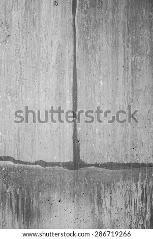 Gritty aged wall made of grey cement with cracks. - stock photo