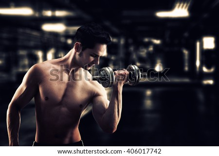 Gritty image of a muscular and fit young bodybuilder fitness male model posing with weights