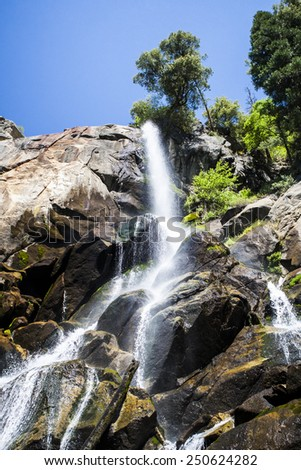 Grizzly Falls is probably the most attractive waterfall on a typical tour into the Cedar Grove section of Kings Canyon National Park. - stock photo