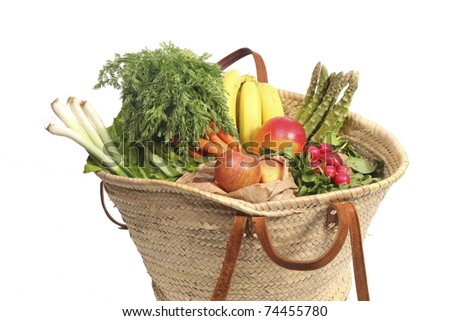 groceries in a wicker shopping bag - stock photo