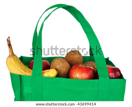 Groceries in Reusable Green Bag Isolated on White - stock photo