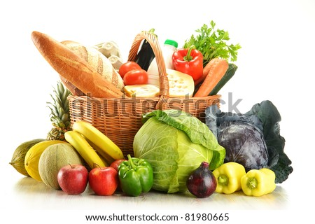 Groceries in wicker basket isolated on white. Vegetables, fruits, bakery products, dairy and wine.