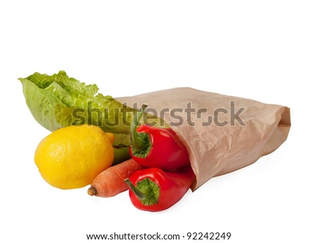 Grocery bag full with fresh vegetables isolated on white background - stock photo