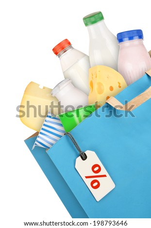 Grocery bag with dairy products isolated on white background - stock photo