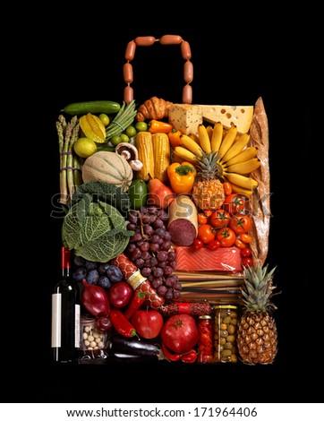 Grocery handbag / studio photography of designer handbag made from different fruits and vegetables - on black background  - stock photo