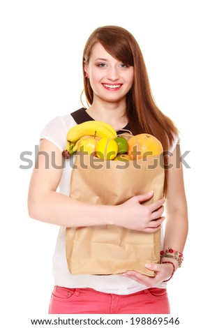 Grocery shop. Woman girl happy client holding recycling paper shopping bag with fresh fruits isolated on white. Healthy food. - stock photo