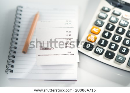 grocery shopping list on notebook calculator stock photo royalty
