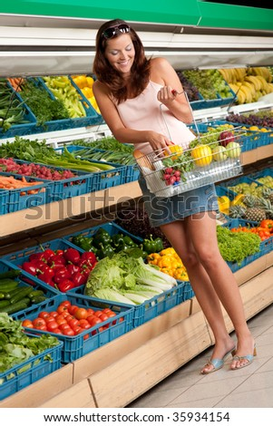 Grocery store: Woman in summer outfit in grocery store - stock photo