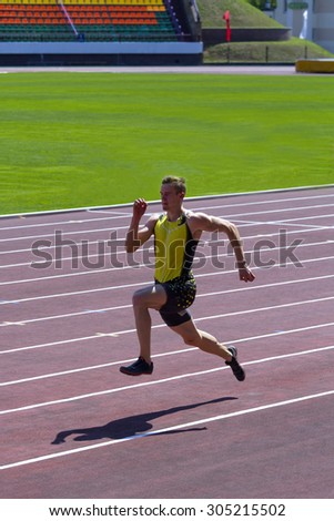 "Grodno, BELARUS - July 25, 2015: Man carries out ""Running jump"" during official selection of participants in the track and field athletics World Cup (Beijing 2015) to July 25, 2015 in Grodno, BELARUS"