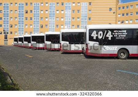 GRONINGEN, NETHERLANDS - AUGUST 22, 2015: Line of city buses at the groningen central station. This station is the main railway hub of the northeastern part of the country