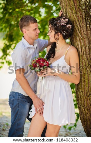 Groom and Bride in a park. Love story of happy couple. wedding dress. Bridal wedding bouquet of flowers. feelings, relations, passion - stock photo