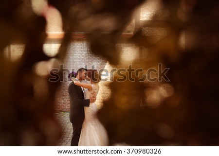 groom and bride in the city on their wedding day - stock photo