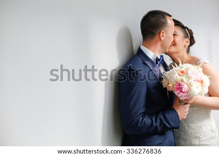 groom and bride kissing - stock photo