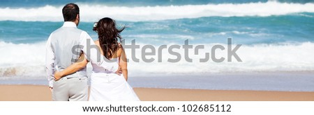 groom and bride on beach