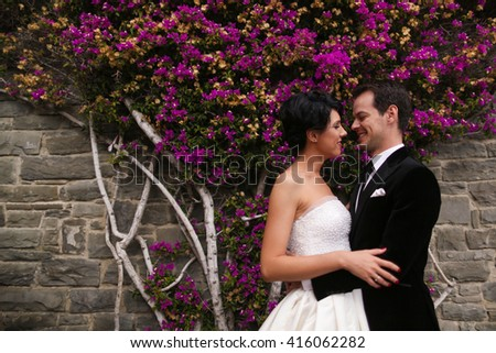 groom and bride posing in nature - stock photo