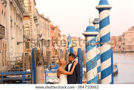 groom and bride posing in the docks - stock photo