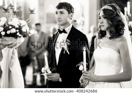 Groom and crying bride in the church