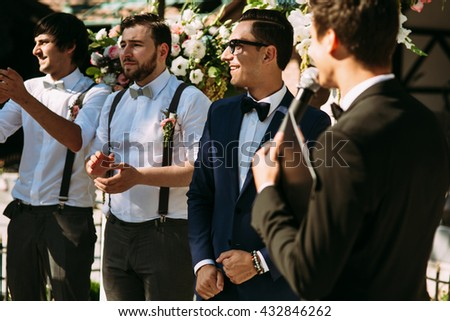 Groom and his groomsmen on the wedding ceremony