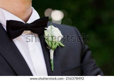 Groom close up with buttonhole - stock photo
