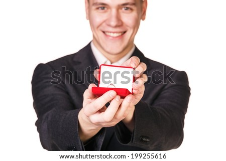 Groom gives the wedding ring in red box - stock photo