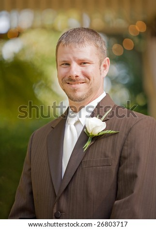 Groom in a Tuxedo Smiling on His Wedding Day - stock photo