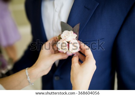 groom in the wedding blue suit with flowers boutonniere on his lapel - stock photo