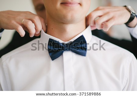 Groom is preparing for his wedding at morning