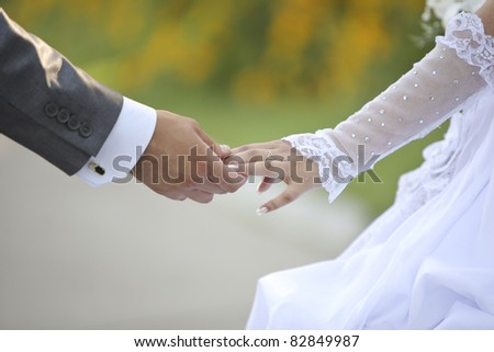 groom keeps a bride hand and walking - stock photo