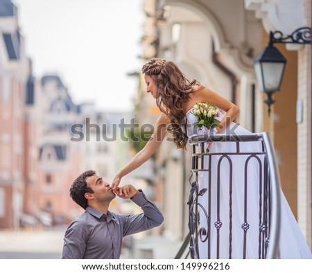 groom kissing bride hand  - stock photo