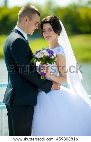 groom looking at bride on sea background