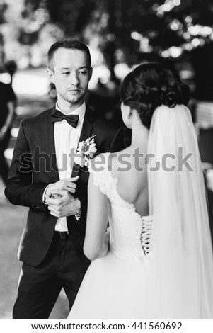 Groom looks at a bride walking to him