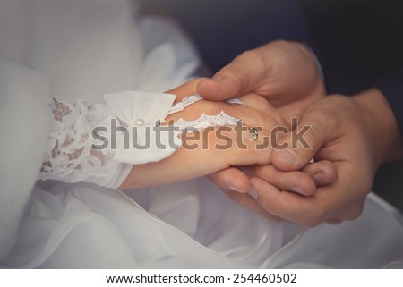groom newlyweds wears ring bride at a wedding couple - stock photo