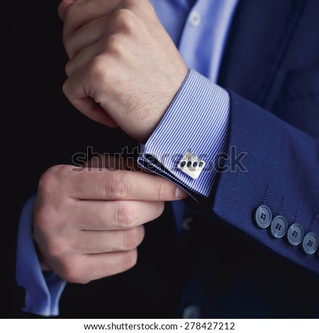 Groom prepares for wedding - stock photo