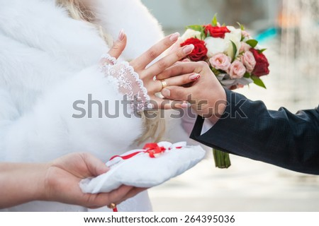 Groom putting ring - stock photo