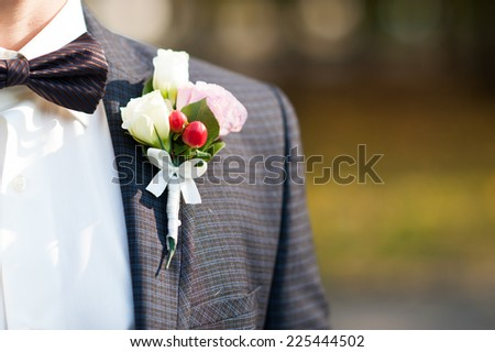 Groom's boutonniere closeup - stock photo
